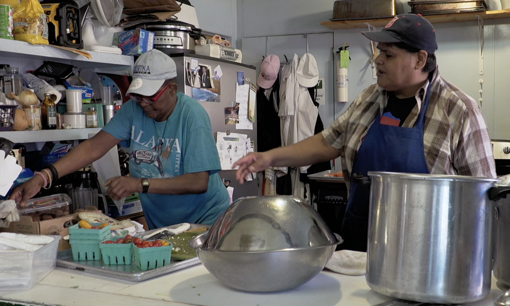 "David organizes the salvation army kitchen in a short film called ""GIVING BACK."""