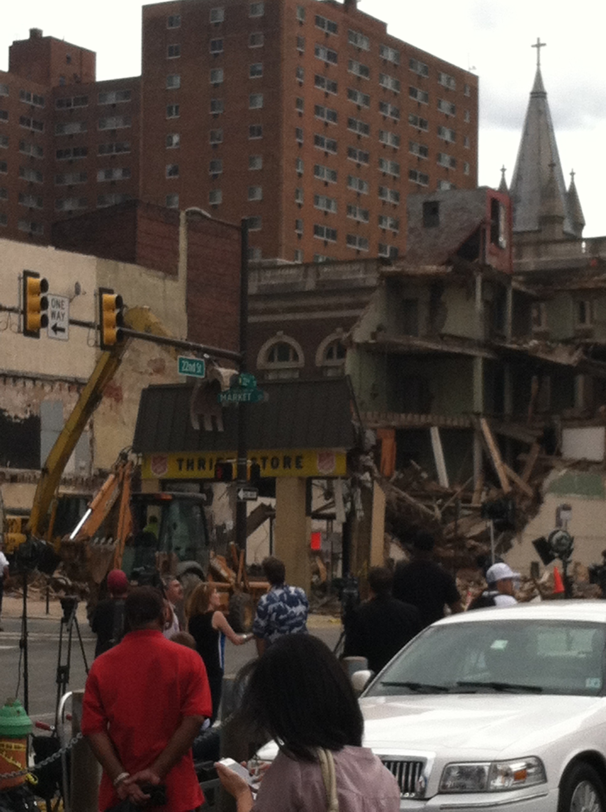 The storefront of the Salvation Army thrift store crushed by the falling building. I took this photo on Thursday after the collapse and before the storefront was taken down.
