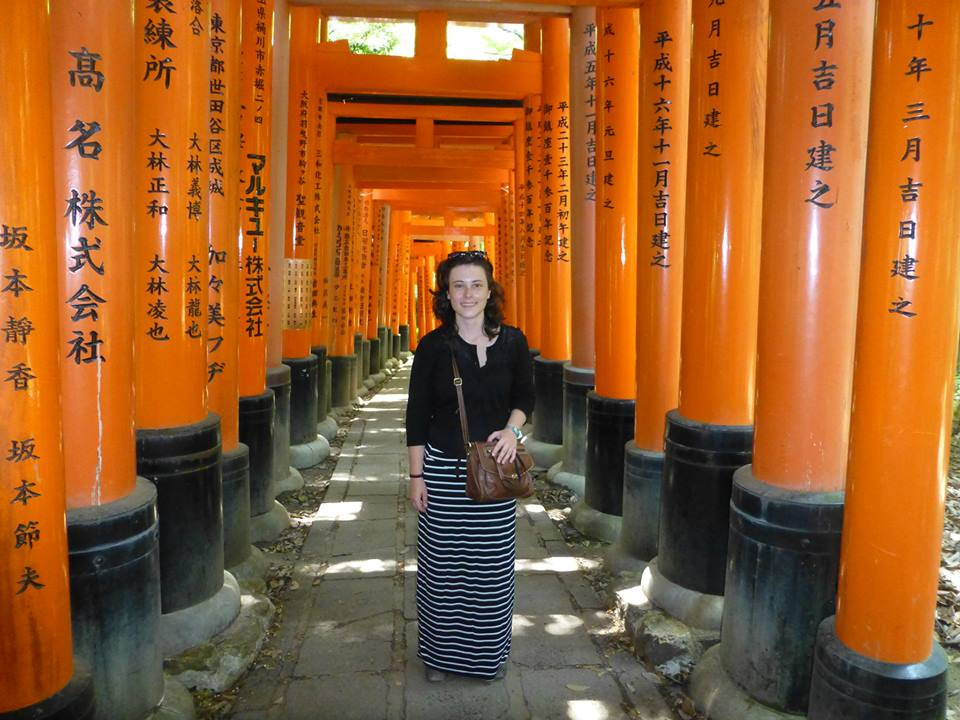 Natalie exploring the endless orange torii of the Fushimi Inari shine, Kyoto, Japan
