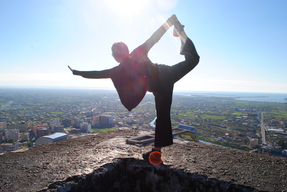 Joyce doing Yoga on a castle overlooking the city Lezhe,Albania