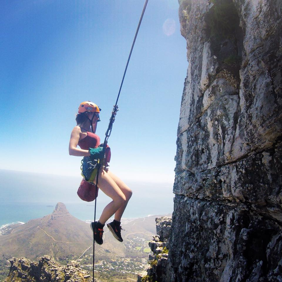 Charlotte abseiling down Table Mountain, South Africa