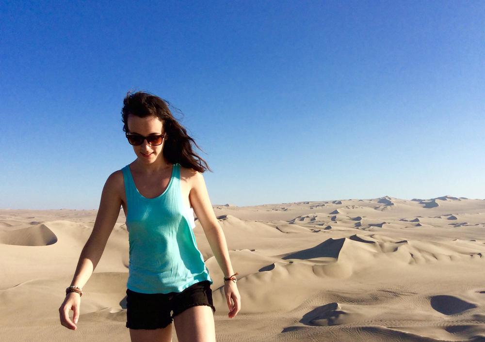 Jessica exploringthe Huacachina Sand Dunes ofIca, Peru.