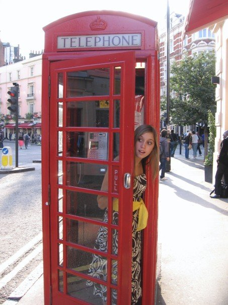 Olivia analysing just how practical red telephone boxes in London, UK actually are.