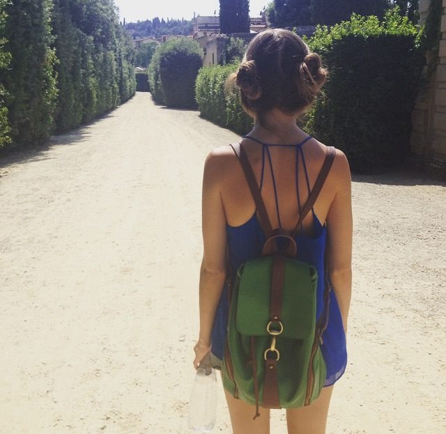 Olivia on the road in Florence, Italy, proving that bunch buns can be pulled off!
