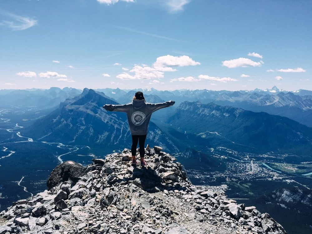 Billie taking in the view of at the top of Cascade Mountain, Alberta, Canada