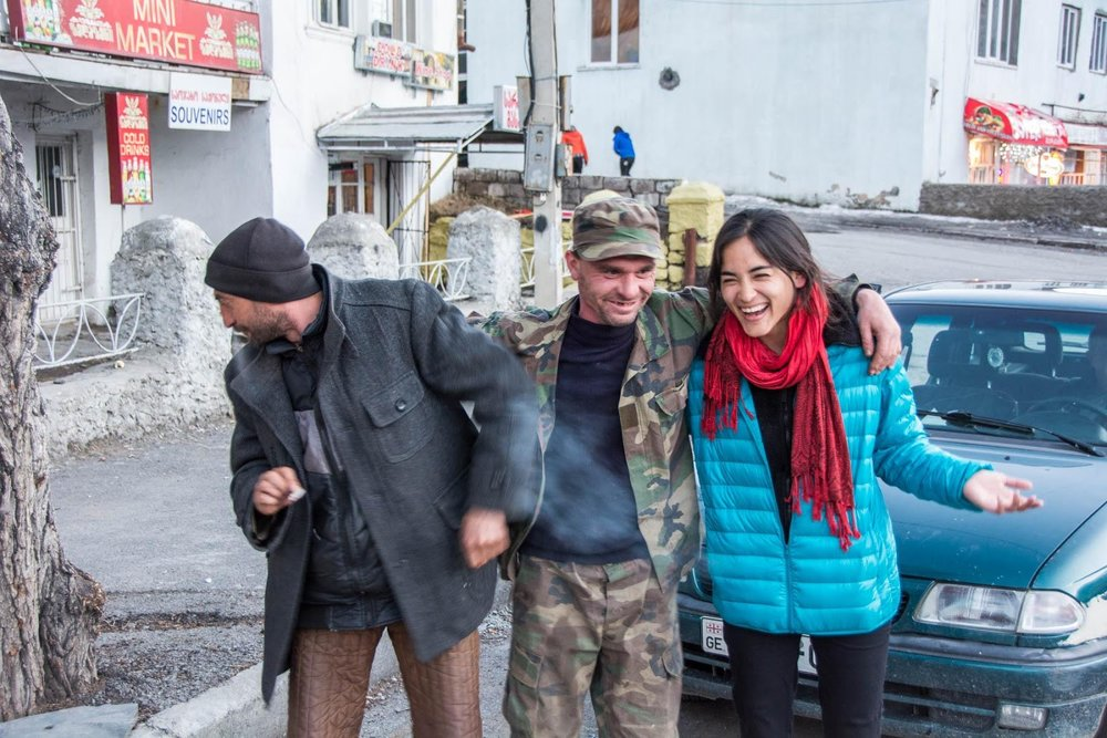 The drunk before the storm with my hitchhiking compatriots in Kazbegi, Georgia