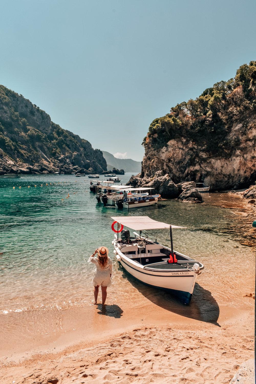 Helene catching some rays on Palaiokastritsa beach, Corfu