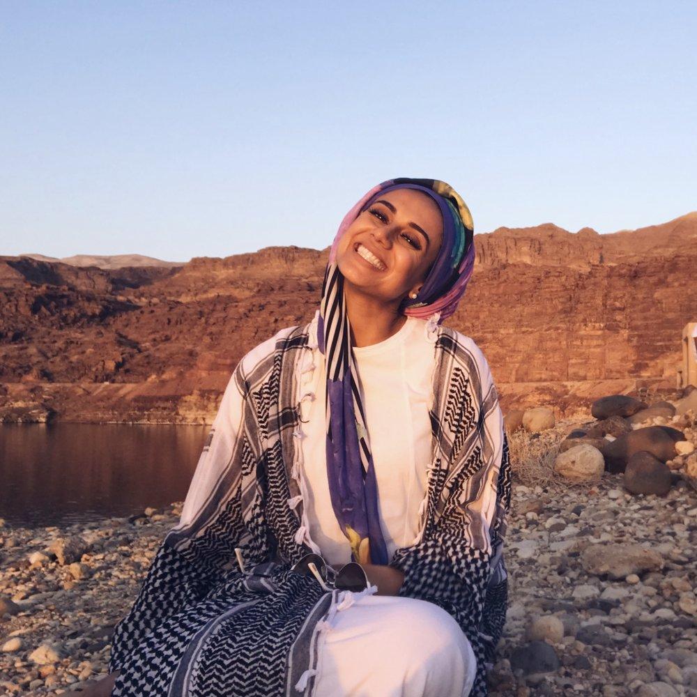 Saira taking in the sunset by the Dead Sea in Amman, Jordan