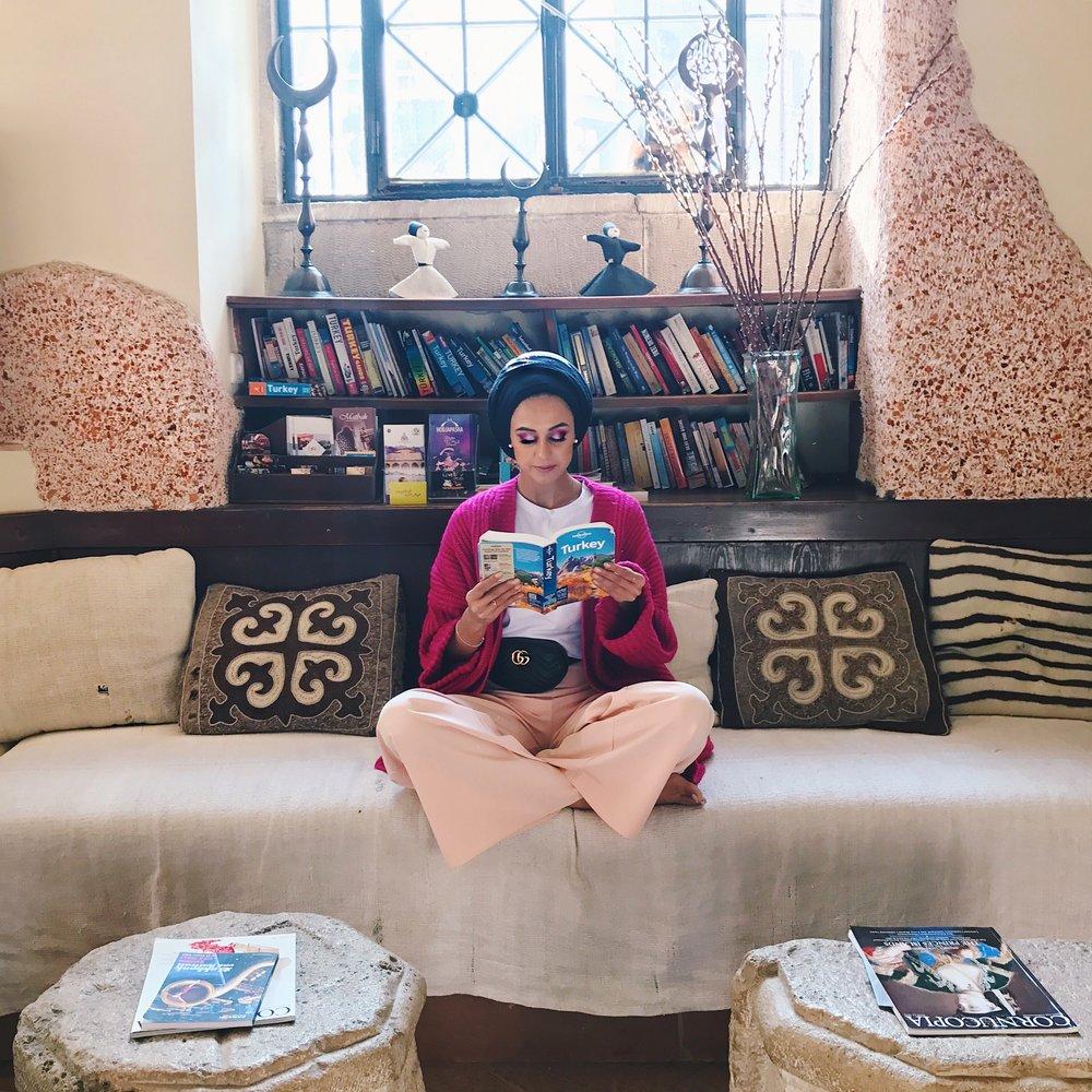 Saira enjoying a spot of reading in the hotel Empress Zoe, Istanbul, Turkey