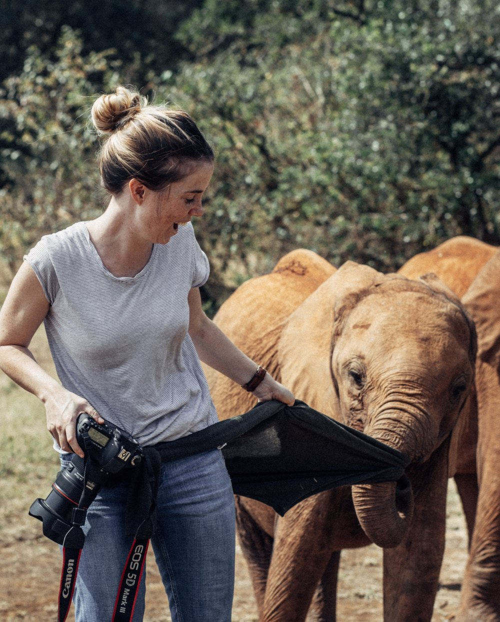 Freya making new (cheeky!) friends while working at the Sheldrick Wildlife Trust, Kenya