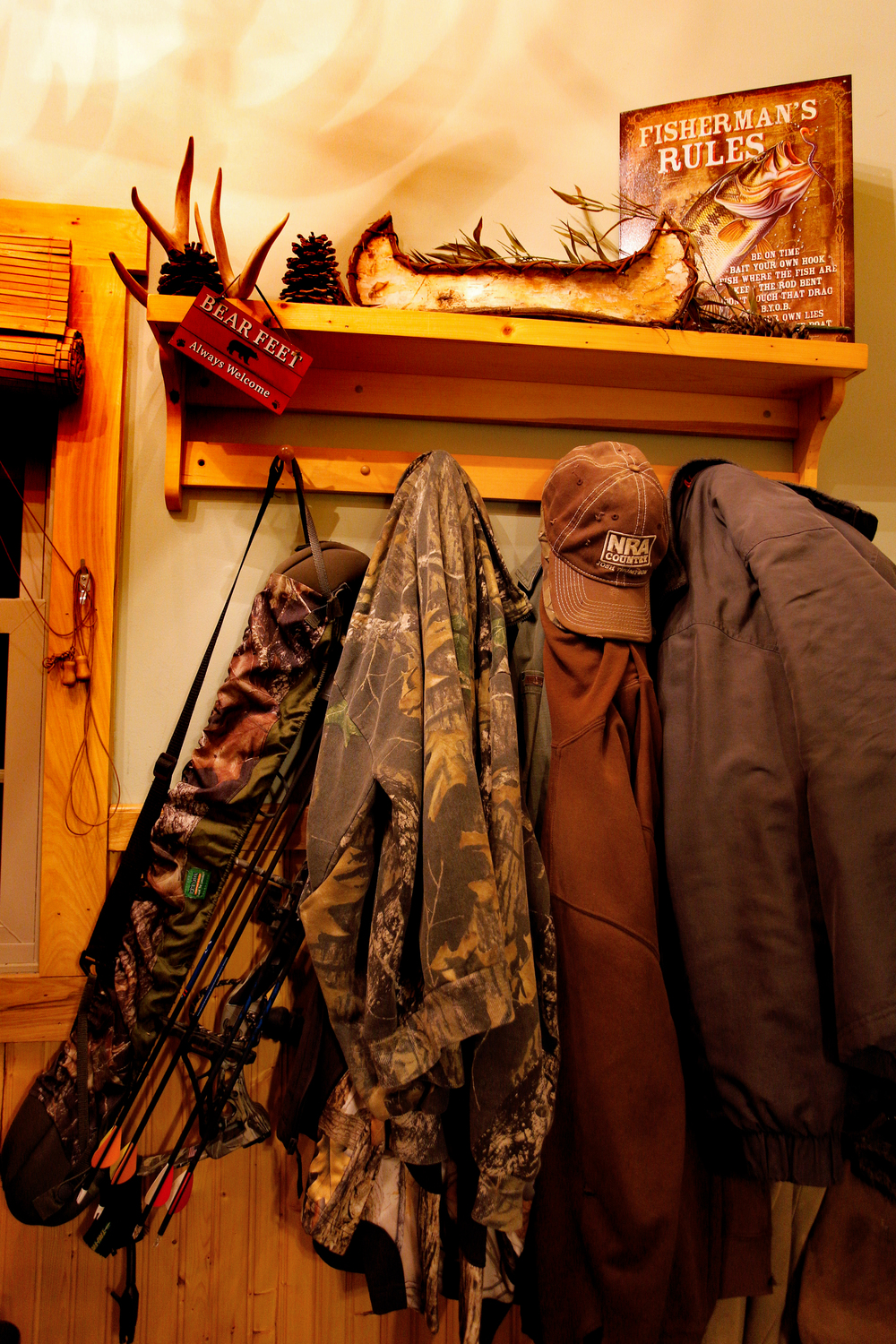 Coats, hats and a crossbow hang on the coat rack of Billy Kittle's home in Glouster, Ohio.