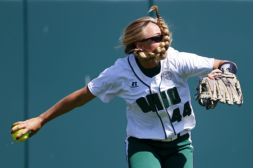 Ohio University outfielder Dakota Pyles looks to throw to second during a game against Miami University at the OU Softball Field in Athens, Ohio.