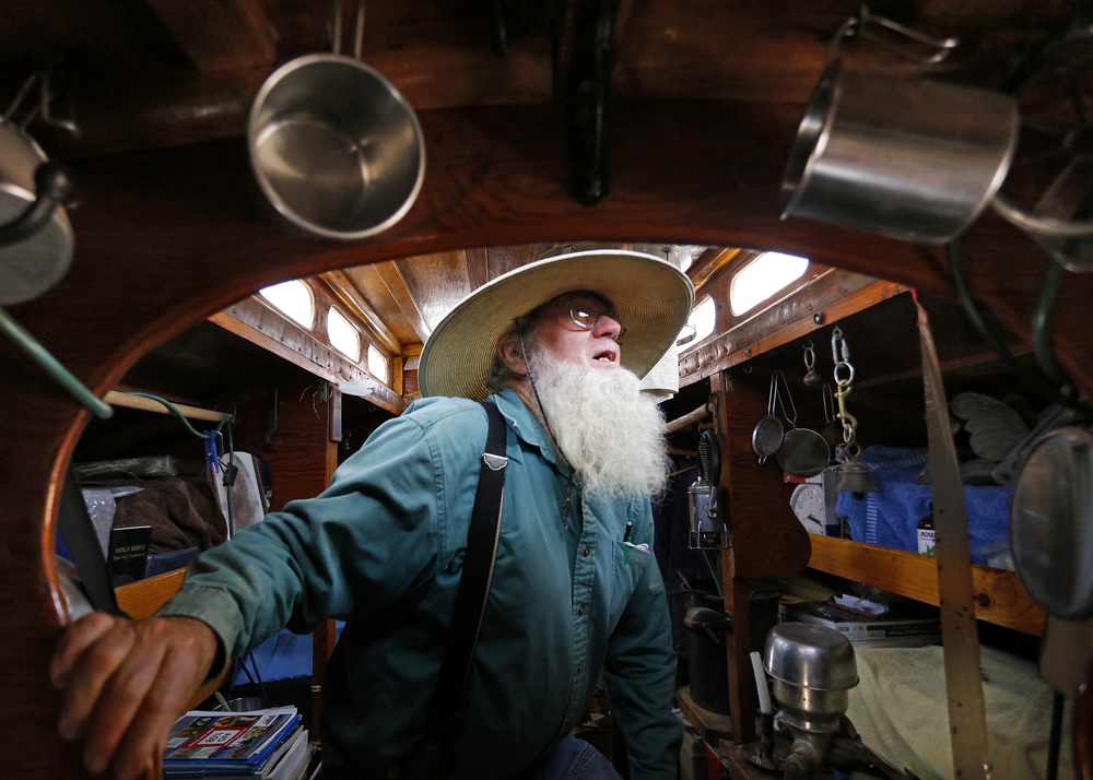 John Stiles walks through his living space in his first trailer at Hoffnungsau Mennonite Church in rural Inman, Kansas. Stiles has been traveling the US for 35 years after leaving Arkansas in 1978 with a wagon and two mules to live a sustainable lifestyle.
