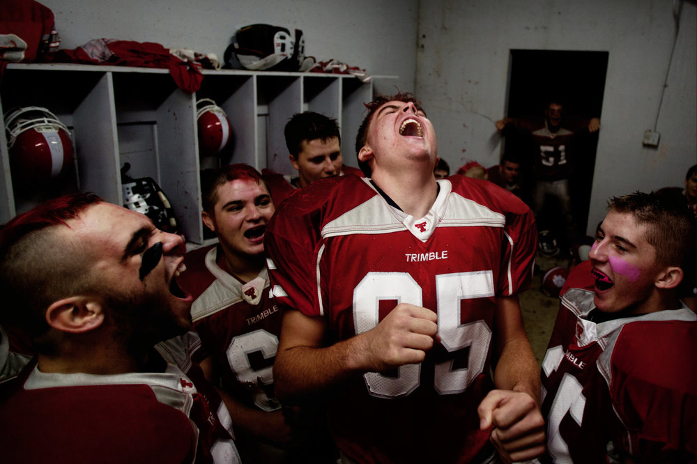 Trimble High School Football players hype themselves up before a game at Glouster Stadium in Glouster, Ohio.