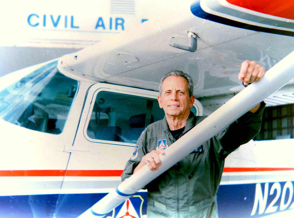 David Moruzzi poses with the Marco Island Civil Air Patrol Cessna airplane at Marco Island Airport in Marco Island, Florida, on Wednesday, June 29, 2015. Moruzzi served 28 years in the United States Air Force and has been flying planes for over 50 years. He now works with the Marco Island Civil Air Patrol on rescue and research missions. Photo taken with a Polaroid 420 Land Camera and Fuji FP-100C film.