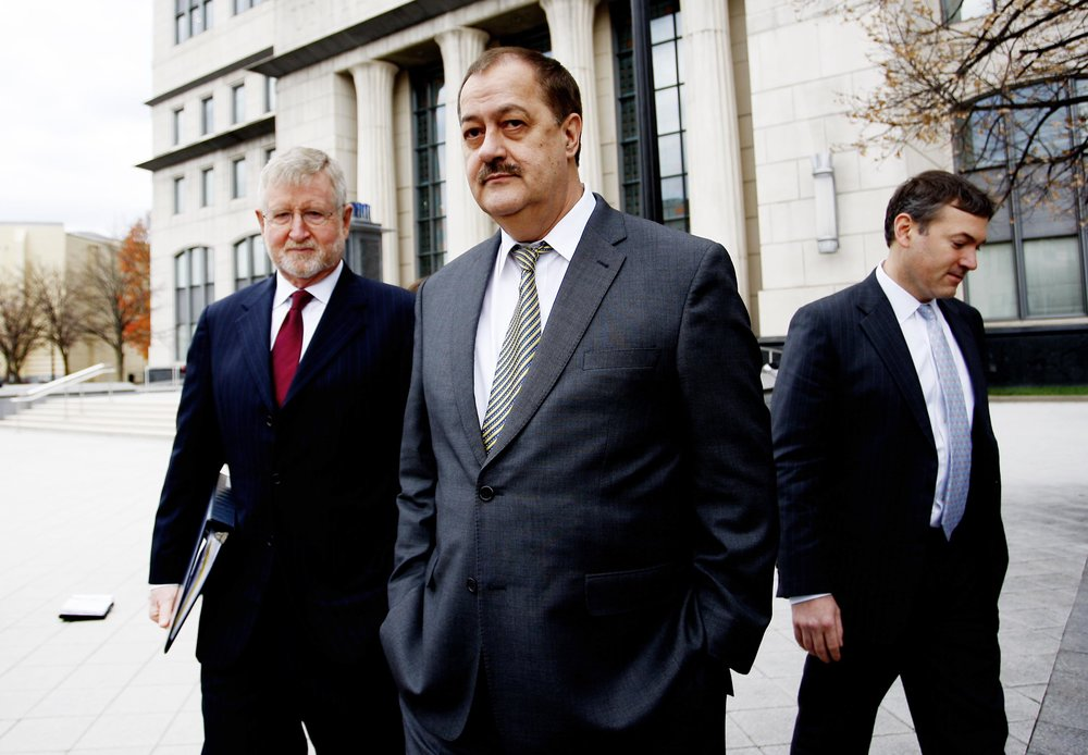 Donald 'Don' Blankenship, former chief executive officer of Massey Energy Co., center, and his attorney Bill Taylor, left, exit the Robert C. Byrd U.S. Courthouse in Charleston, West Virginia, U.S., on Thursday, Dec. 3, 2015. Blankenship, one of Appalachias last coal barons, was found guilty of plotting to speed up production by ignoring safety rules at a company mine that later blew up killing 29 workers.