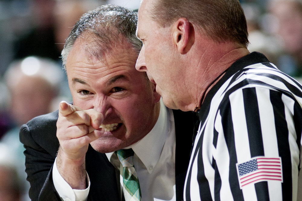 Ohio Bobcats Men's Basketball Head Coach Saul Phillips agues with the referree during a game against Sam Houston State University at the Convocation Center in Athens, Ohio.