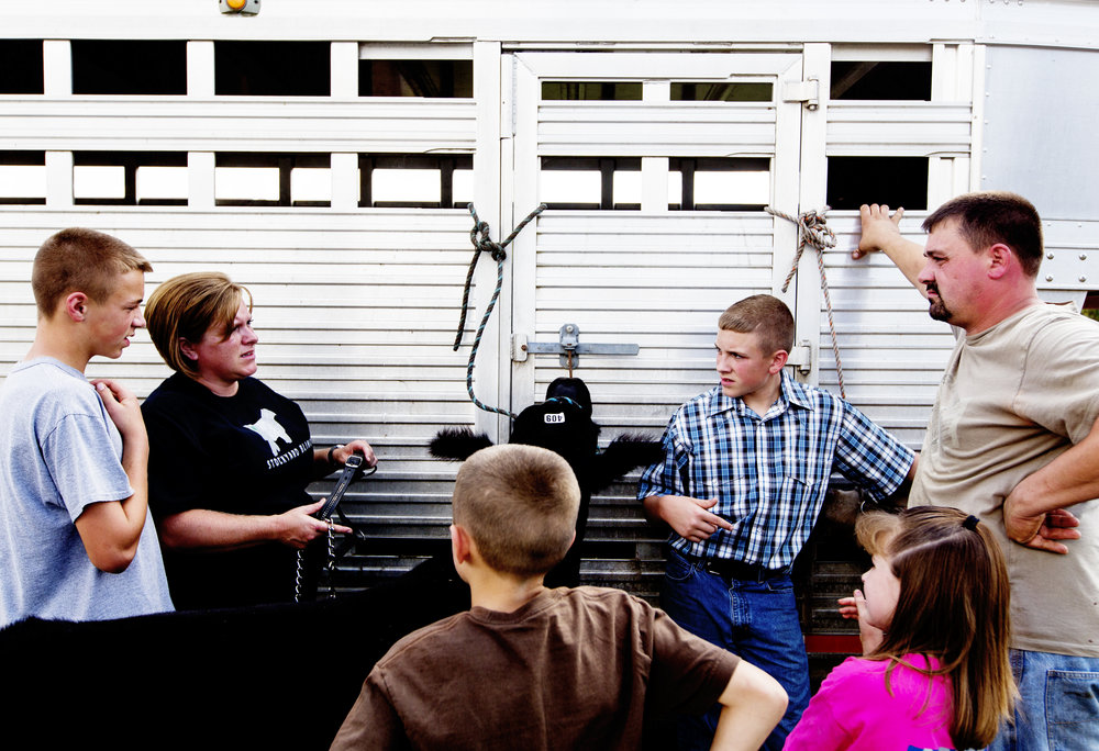 The Weber family, from left, Braden, Sheila, Levi, Tyler, Abby and Steve, attend the Ohio Cattleman's Association Feeder Calf Show at the Athens County Fairgrounds in Athens, Ohio.