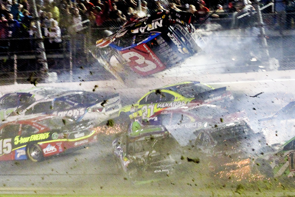 Austin Dillon (3) goes airborne upside down in a crash on turn one after the final lap during the Coke Zero 400 NASCAR Sprint Cup race at Daytona International Speedway in Daytona Beach, Florida.