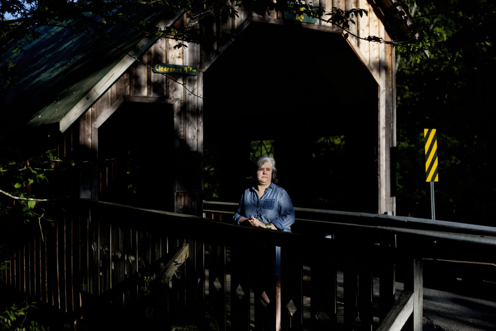 Allyson Virden, former manager of LeConte Lodge in Gatlinburg, poses for a portrait at Emerts Cove Covered Bridge in Pittman Center, Tennessee. Virden and her husband braved the November 2016 wildfires that had threatened to burn down LeConte Lodge.