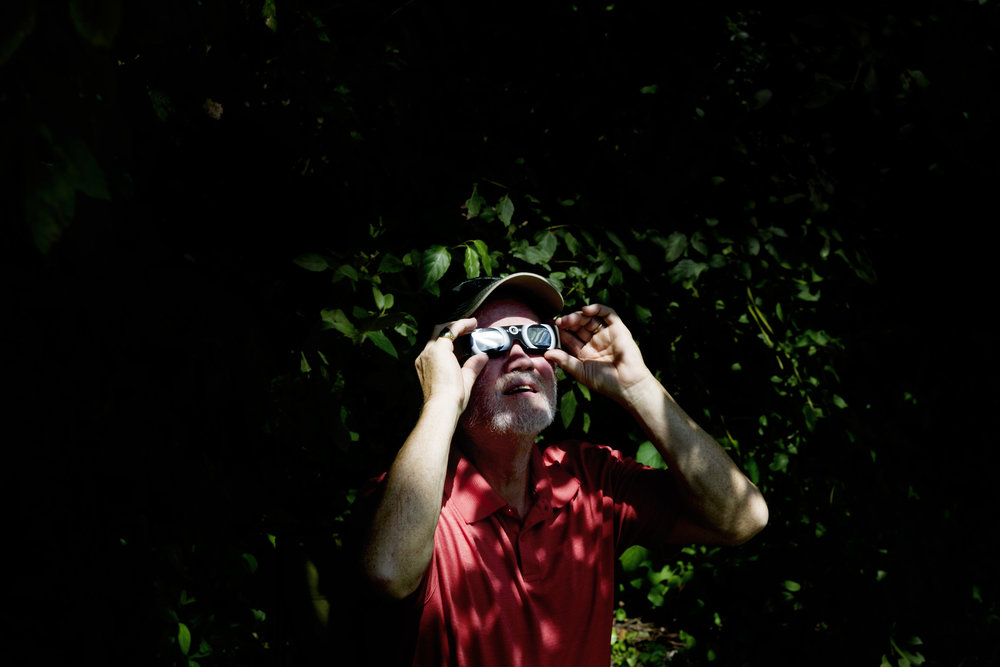 John Randolph, of Blacksburg, Virginia, watches the solar eclipse through solar glasses during the total solar eclipse festival in Sweetwater, Tennessee on Monday, August 21, 2017. Sweetwater is expected to experience over two minutes of complete totality.