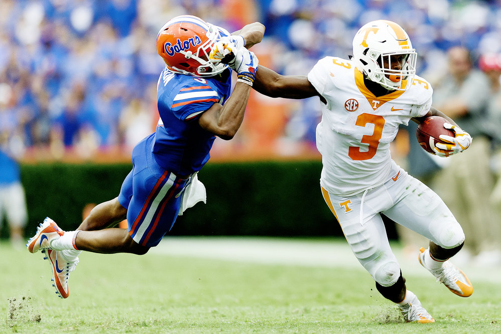 Tennessee running back Ty Chandler (3) pushes away Florida cornerback Marco Wilson (3) as he runs the ball down the field at Ben Hill Griffin Stadium in Gainesville.
