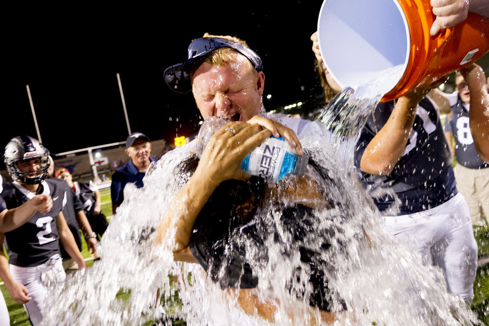 Anderson County Head Coach Davey Gillum and his wife Margarita are drenched with water during the celebration during a game between Anderson County and Heritage at Anderson County High School in Clinton, Tennessee.