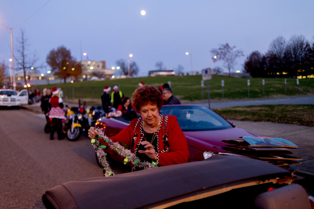 Margie Floyd, of Knoxville, decorates her car before the annual WIVK Christmas Parade along Gay Street in Knoxville.