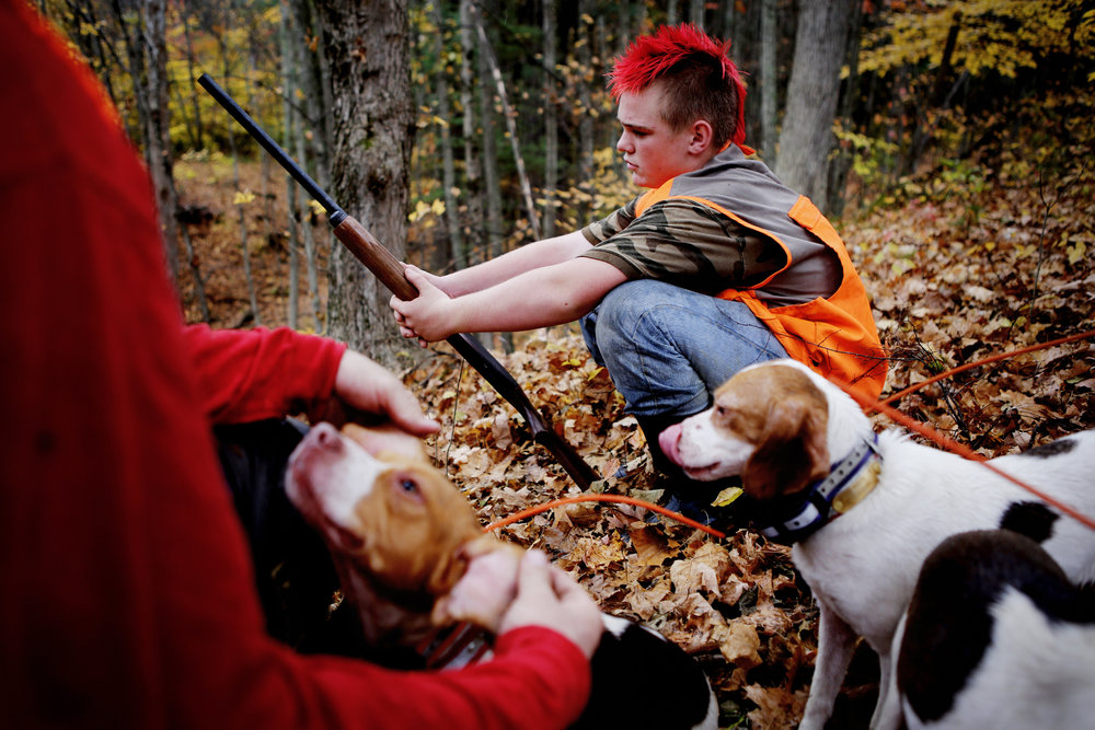 Sawyer Koons takes a break from rabbit hunting in rural Glouster, Ohio.