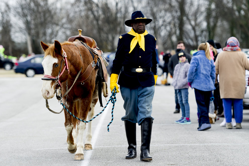Will Minter, of Knoxville, dressed in his Buffalo Soldier Captain's uniform, walks with his horse Parrot Leo before the start of the annual MLK Memorial Parade along Martin Luther King Jr. Ave. in Knoxville, Tennessee on Monday, January 15, 2018.