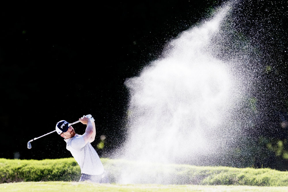 Wade Boteler hits from the bunker during the first round of play at the Knoxville Open at Fox Den Country Club in Farragut, Tennessee.