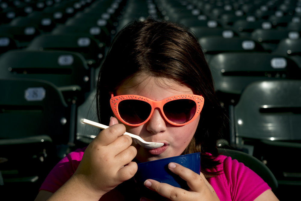 Makayla Graham, 9, of Clinton, enjoys an ice cream during a game between the Tennessee Smokies and Montgomery Biscuits at Smokies Stadium in Kodak, Tennessee on Friday, June 15, 2018.