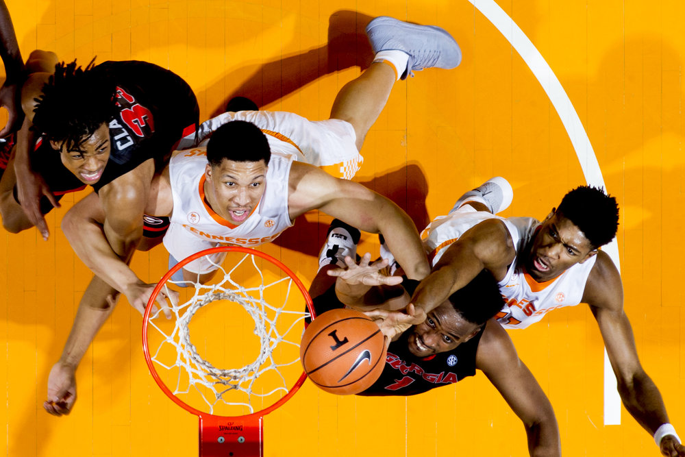 Georgia forward Yante Maten (1) goes for a layup as Tennessee forward Grant Williams (2) and Tennessee forward Kyle Alexander (11) defend during a game between Tennessee and Georgia at Thompson-Boling Arena in Knoxville.