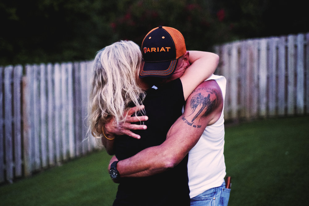 Gary Christian hugs his wife, Lori, at their West Knoxville home Knoxville. Christian lived for 11 years only to plot to kill the people who tortured, raped and murdered his 21-year-old daughter, Channon. On the day her body was found crammed in a trash can, her father – who had been a Baptist since he was 8 – screamed at God he was done with him. 11 years later, he fell on his knees at his daughter's grave and asked God to come back. Now he tells his testimony and urges others to open their souls to the Lord.