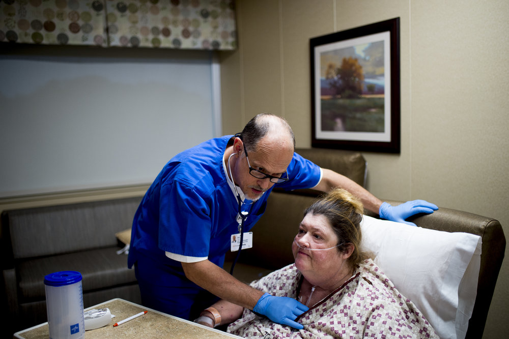 David Trout, a nurse at the University of Tennessee Medical Center, check the lungs of patient Ruth Shipley in Knoxville. Trout is the Health Care Hero in the nurse category.