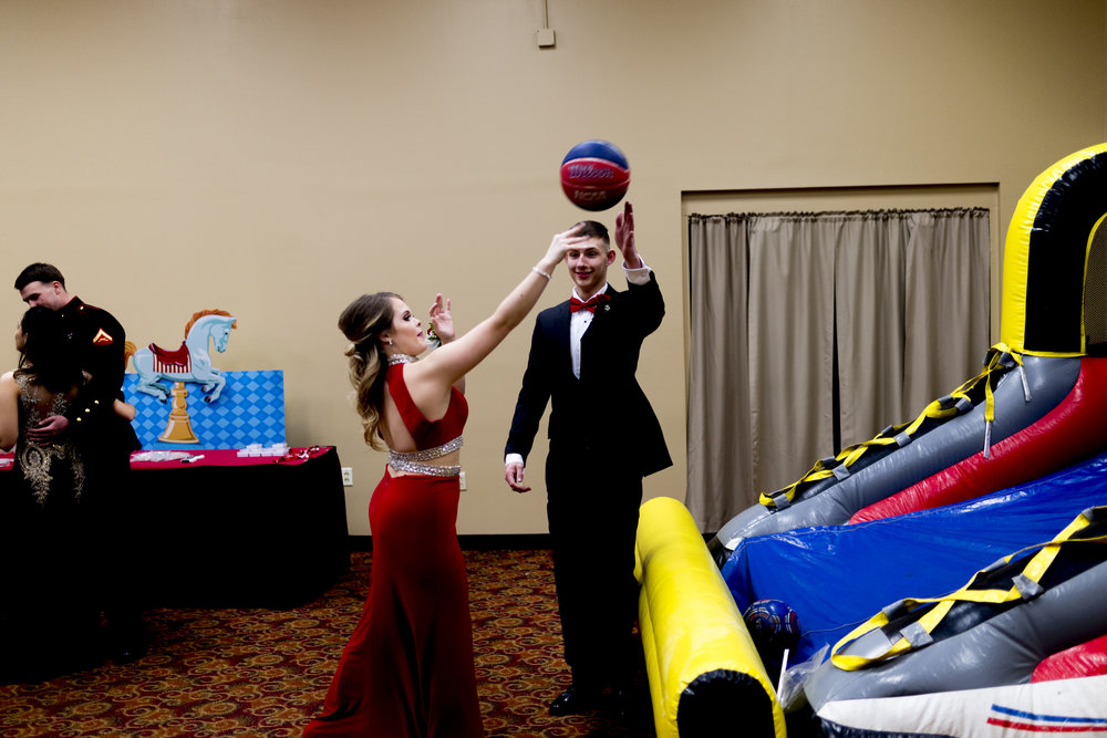 A couple plays a game at the Hardin Valley High School prom at The Grand Event Center in Knoxville.