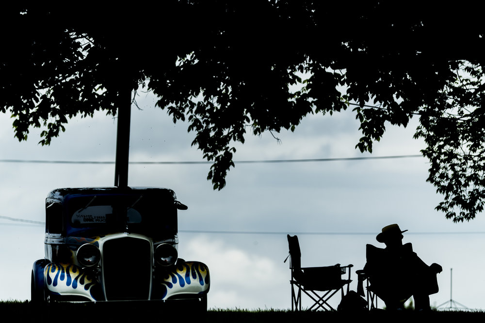 Jim Worrell sits beside his 1935 2-door Chevy at the 44th annual Street Rod Nationals South at Chilhowee Park in Knoxville.