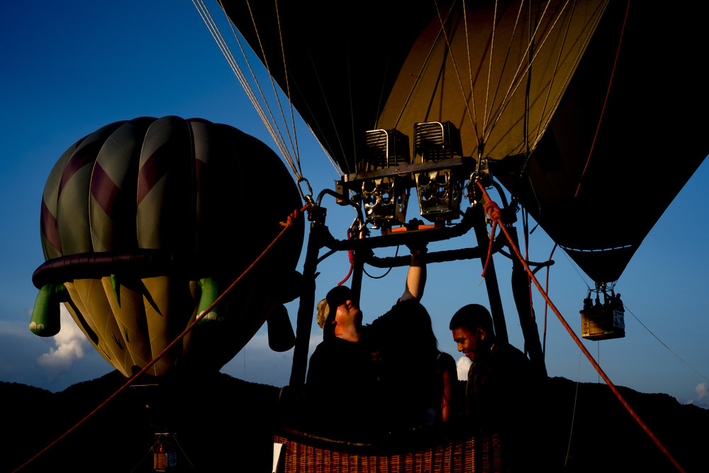 Sean Richardson gives Jamie Velasquez, of Chattanooga, and Erik Lopez a ride in his hot air balloon at the second annual Smoky Mountain Balloon Festival in Townsend, Tennessee. The festival featured several hot air balloons, food trucks, wine tasting and live entertainment.
