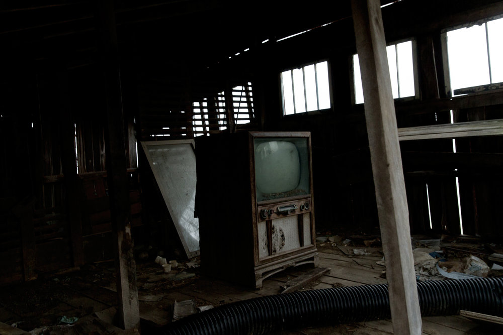 Old television inside an abandoned barn, Morgan County, Ohio, 2016.