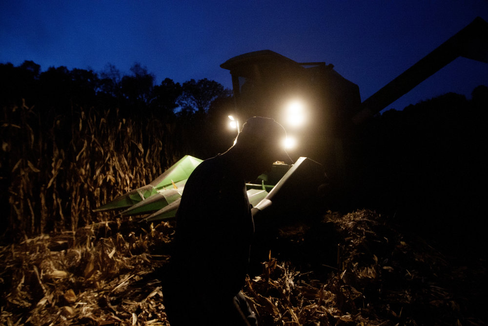 Farmer Paul Southall calls it a night from harvesting corn late in the evening after his John Deere combine broke down.