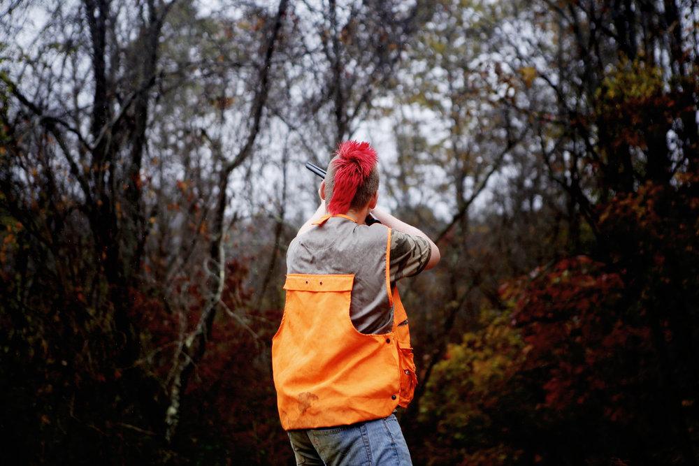 Sawyer Koons shoots his shotgun while hunting in rural Morgan County, Ohio.