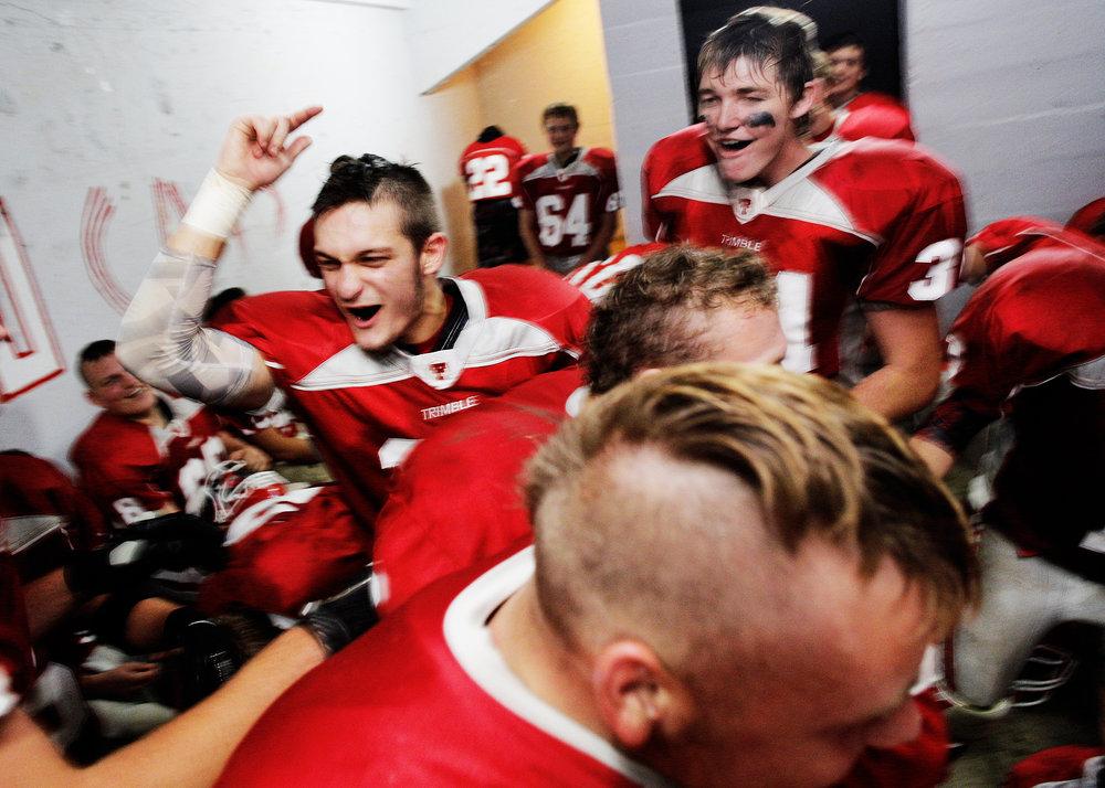 Trimble High School football celebrates a win in the locker room. Glouster, Ohio, September 2014.