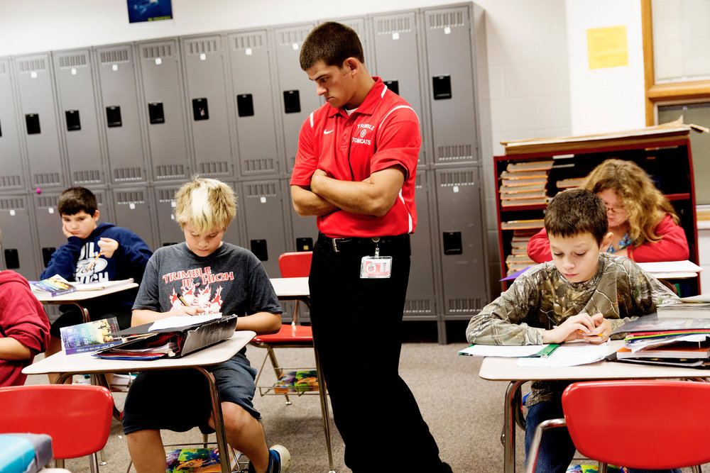 Joey Reitano watches as his fifth-grade English students do their work. Reitano has over 50 head of cattle, but cannot make a living full-time as a farmer, and works as a teacher at Trimble Elementary School.