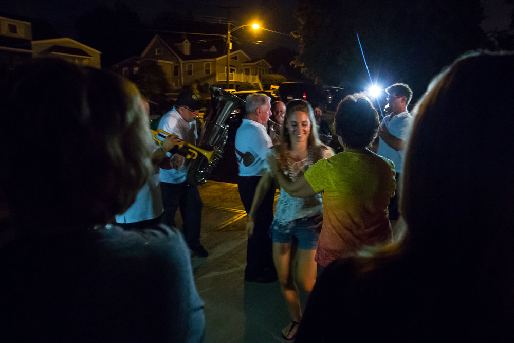 Natalee Bufalini, granddaughter of Henry, center, dances with Grace Tisch while the Ballabe band plays in the background in Aliquippa on Friday evening. Each year after the first night of the festival, the Ballabe band goes to multiple houses to play traditional songs and to eat and drink with close friends and family.