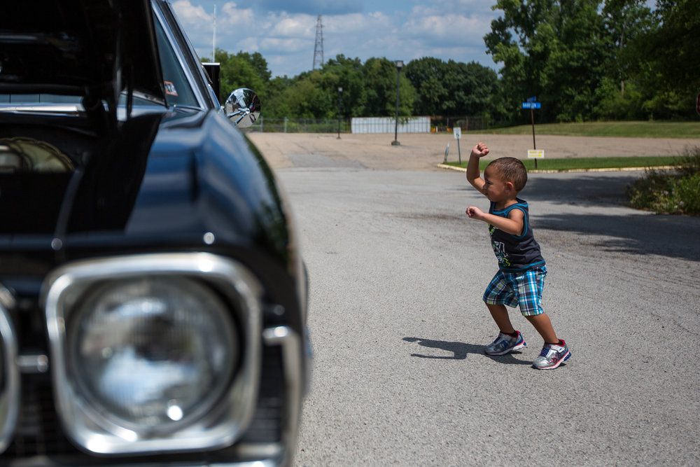 Joycean Thomas, 2, dances while looking at a car at the Rochester Fireman's Car Cruise on Saturday morning. The event had cars from all around the area, food vendors and an all day band.