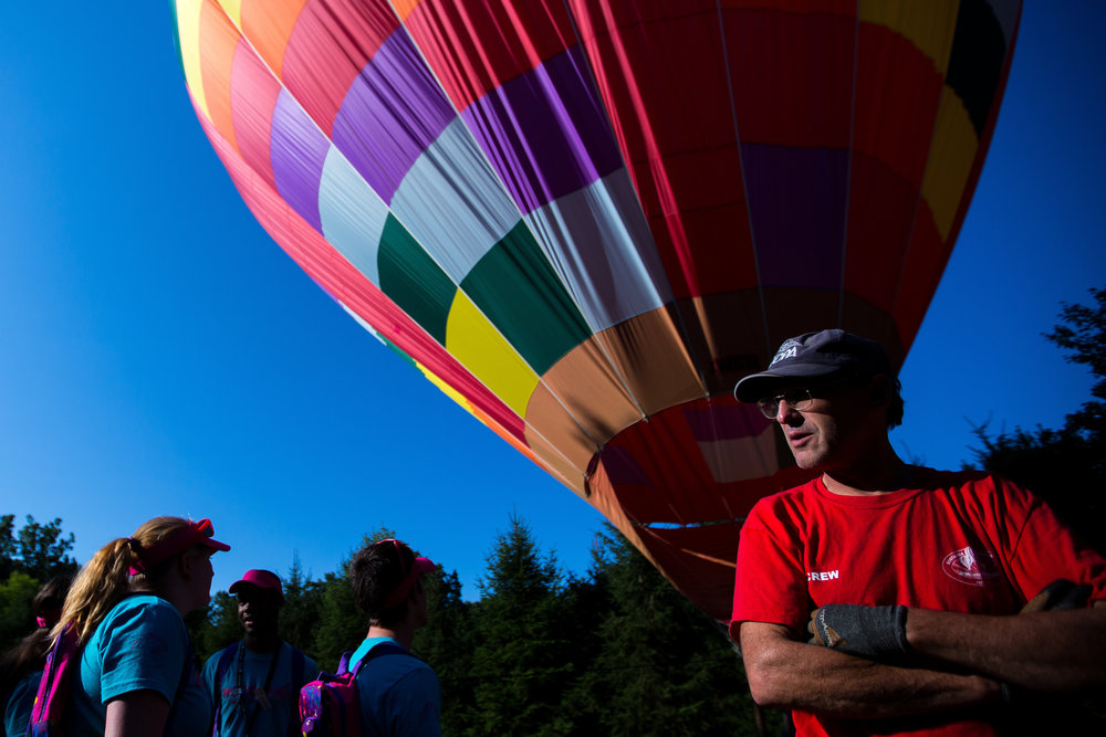 John Royer, of Nostalgia Ballooning from the Chicago area, watches and he and partner Chad Morin wait for steady winds so they can take kids from Camp Inspire on rides at the Woodlands Foundation on Tuesday morning. Nostalgia Ballooning drove to Wexford to team up with the Woodlands Foundation and the Children's Hospital of Pittsburgh of UPMC to host Camp Inspire, a six-day camp dedicated to ventilator-dependent children.