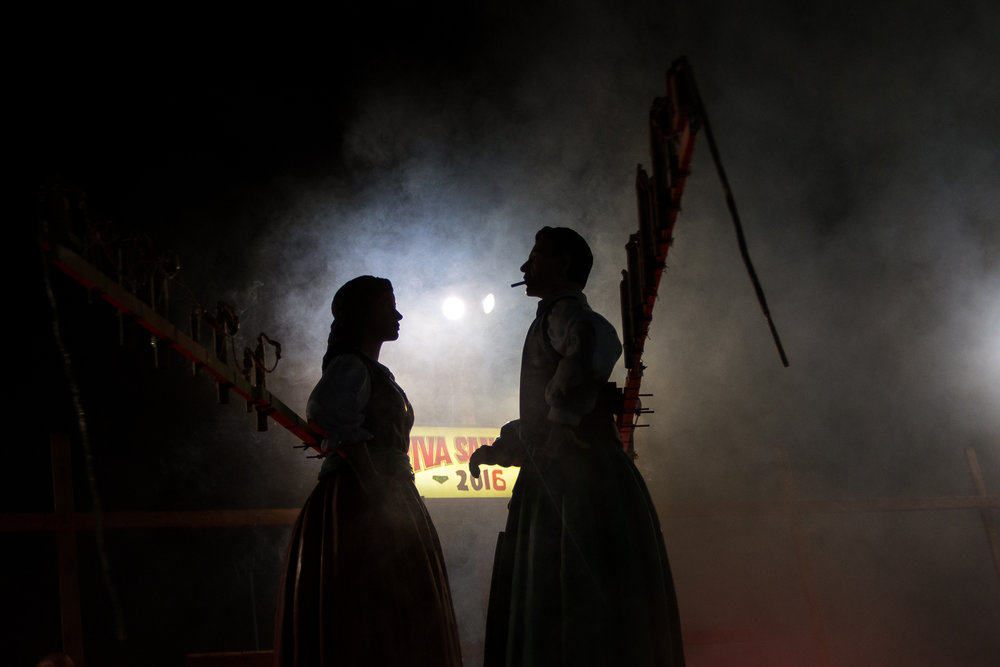 Smoke clears after the fireworks have concluded near the end of the Baby Doll Dance, which is accompanied by music from the Ballabe Band at the 91st San Rocco Festa in Aliquippa on Sunday night. Henry Bufalini, in the male costume on the right, has participated in the dance since 1987.