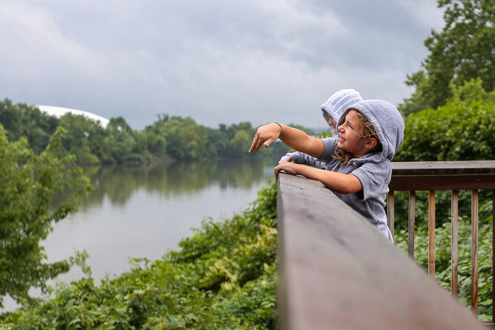 Vega Meredith, 8, watches as she throws a rock into the Ohio River from an overlook in Coraopolis on Wednesday afternoon.
