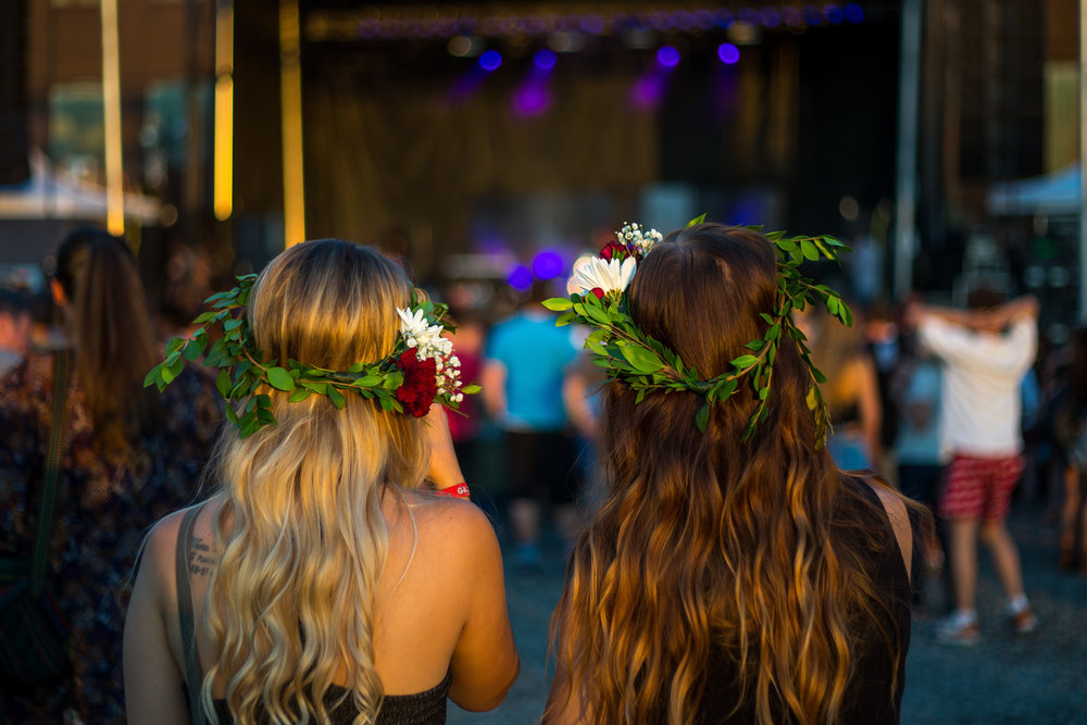 Sisters Christine, left and Gillian Mullias watch as Daya, a local singer and songwriter, preforms on stage on day one of Thrival Music Festival in Rankin on Friday evening.