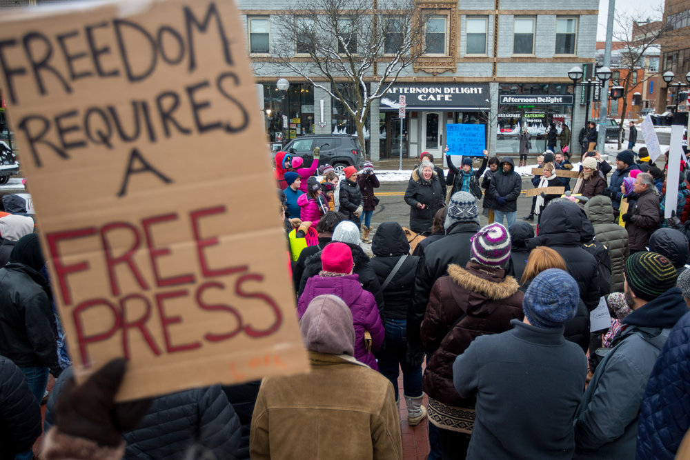 People gather outside of the federal Building in downtown Ann Arbor to protest President Trump's anti-immigration policy on Sunday, January 29, 2017. About 200 people attended the protest. Matt Weigand | The Ann Arbor News